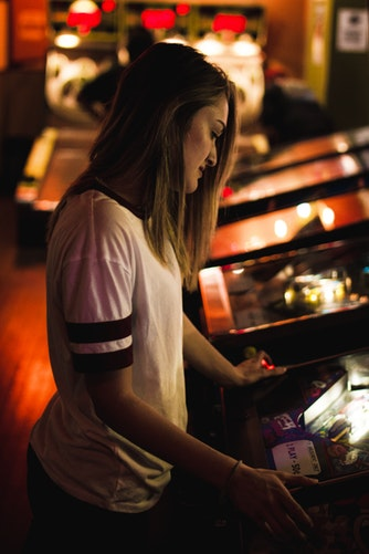 woman playing in an arcade